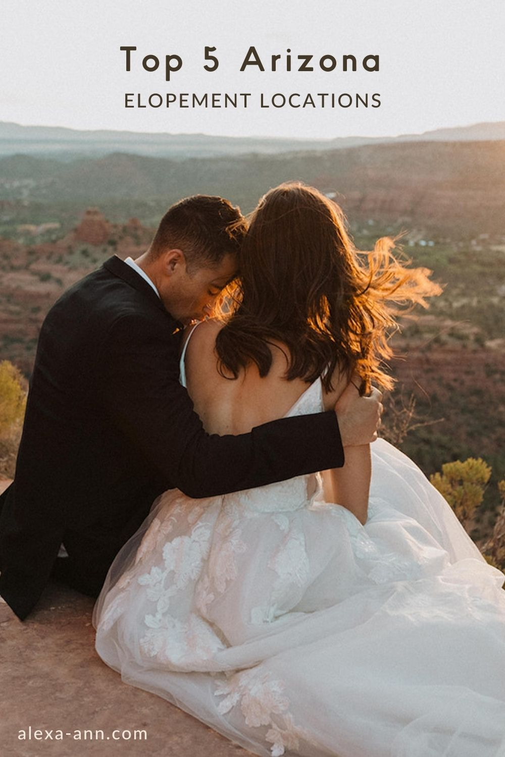 A groom embraces his bride as they sit overlooking the Arizona valley during sunset. Image by Alexa Ann Photography overlaid with text that reads Top 5 Arizona Elopement Locations.