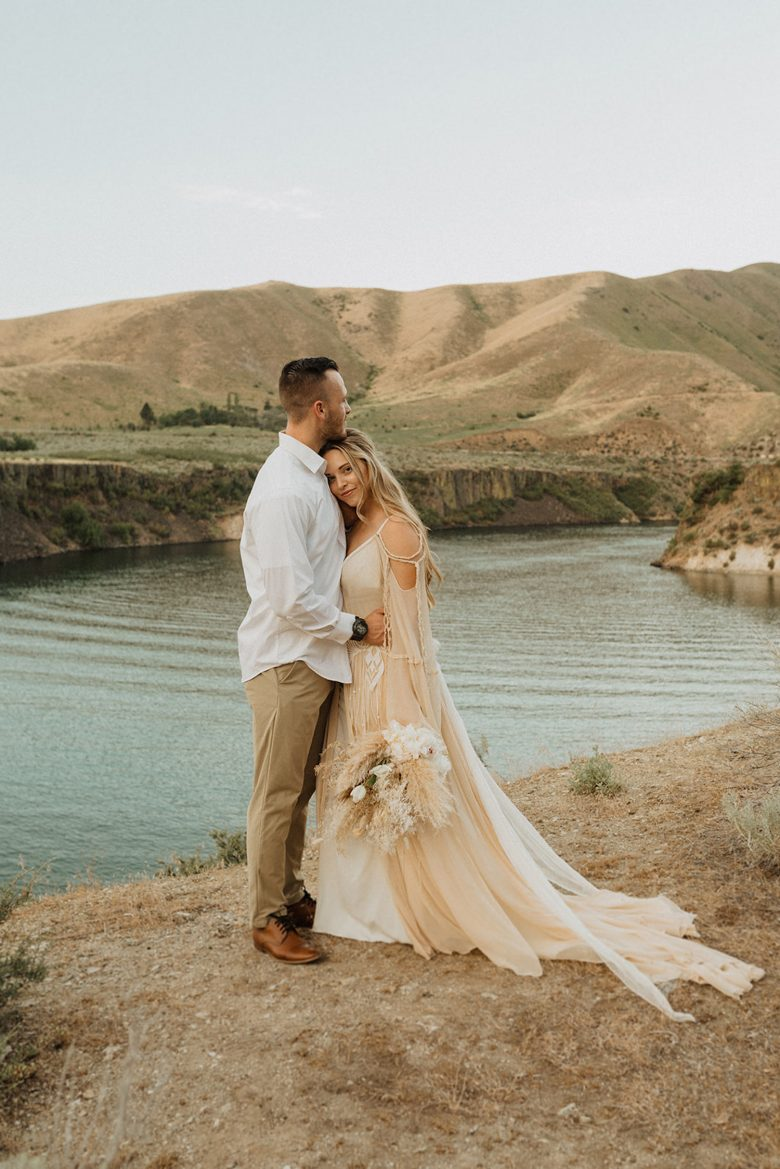 Couple pose in front of a lake in the Pacific Northwest for their elopement, captured by Alexa Ann Photography