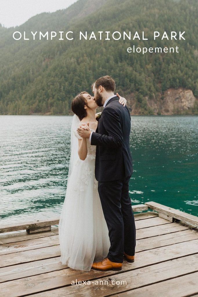 A bride and groom kiss while standing on a dock near a lake in Washington State; image overlaid with text that reads Olympic National Park elopement