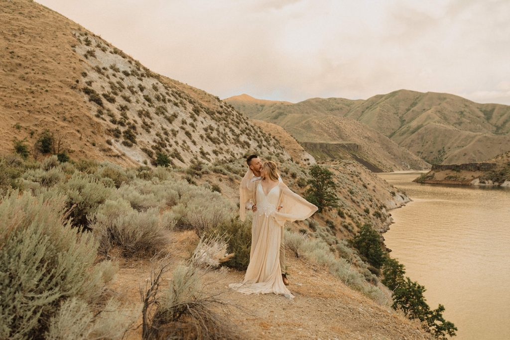 Couple poses for a photo in the desert in Wyoming, a top elopement destination in the Pacific Northwest, taken by Alexa Ann Photography