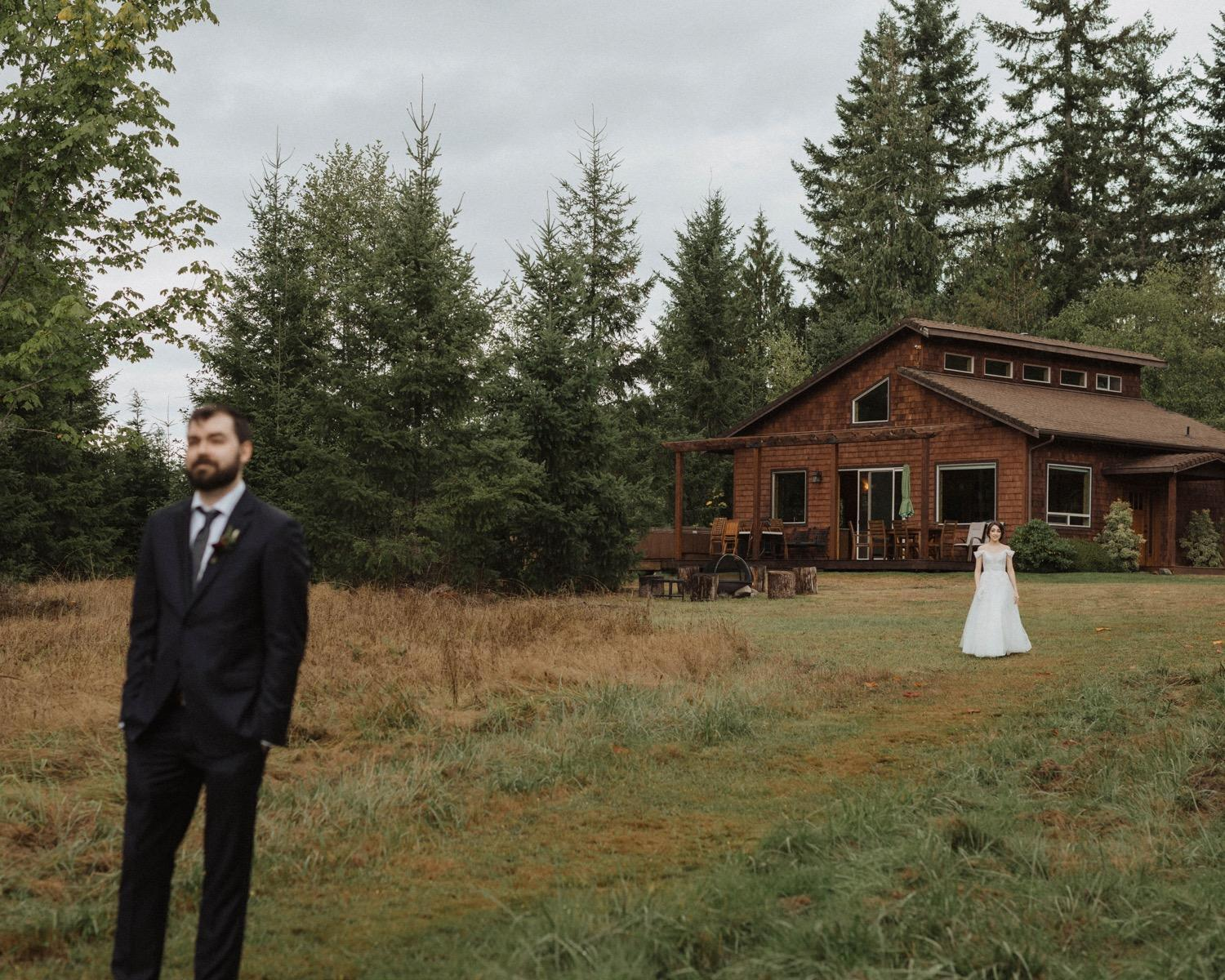 Couple doing a first look at the Lake Crescent House on the Water